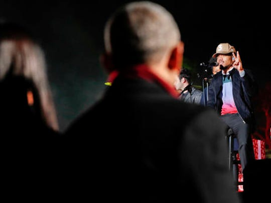 """FILE - In this Dec. 1, 2016, file photo, President Barack Obama, center, and first lady Michelle Obama, left, listen to Chancelor Bennett, """"Chance the Rapper"""", right, from Chicago, perform at the lighting the 2016 National Christmas Tree ceremony at the Ellipse near the White House in Washington. The rapper tweeted a photo of himself on Feb. 2, 2017, wearing Obama-themed clothing."""