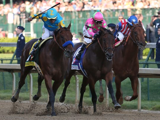 (L-R) Victor Espinoza rode American Pharoah ahead of Gary Stevens aboard Firing Line and Martin Garcia aboard Dortmund to win the Kentucky Derby at Churchill Downs.May 2, 2015This was the first leg of the Triple Crown that would eventually go to American Pharoah.  I like the photo because this three-way battle was the biggest test for the champion.