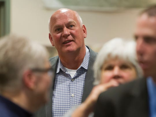 Barry Richard watches the election result come in at the Tippecanoe County Office building Tuesday, November 4, 2014, in Lafayette. Richard defeated Chris Schiuszi for the Tippecanoe County Sheriff race.