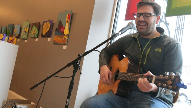 Local musician Noah Jones performs at Element of Art during First Friday.