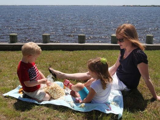 Jen Zeigler,  Toms River, with her son, Brendan, 3, right and her niece Emma LaFera, 4, Toms River, relax bt the bay  during the 17th Annual Barnegat Bay Festival at Wanamaker Park in Island Heights.    Sunday June1, 2014, Island Heights Photo by Robert Ward