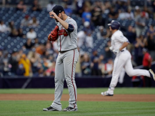 Atlanta Braves starting pitcher Jaime Garcia, center, waits as San Diego Padres' Hunter Renfroe rounds the bases after hitting a two-run home run during the fifth inning of a baseball game Thursday, June 29, 2017, in San Diego. (AP Photo/Gregory Bull)