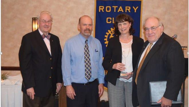 Linda Mayo accepts the Rotary Excel Award.