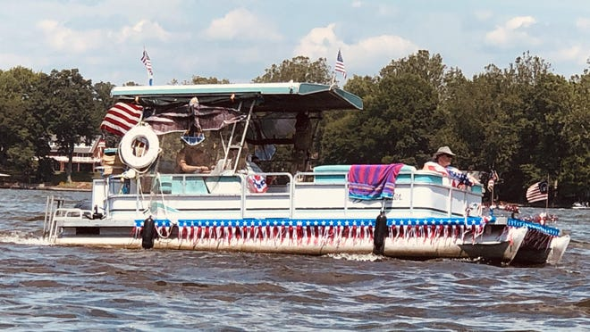 One of the dozens of decorated boats on the Portage Lakes for the unofficial Boat Parade over the Fourth of July weekend.