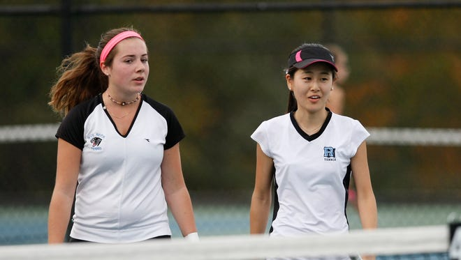 Rye Neck's doubles partners Clemence Balzano, left, and Mizuki Shionya walk towards the net during the girls sectional tennis finals at Harrison High School on  Thursday, Oct. 22, 2015.