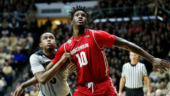 Basil Smotherman fights Nigel Hayes of Wisconsin for rebounding position during a Purdue free throw attempt Sunday, January 8, 2017, at Mackey Arena. Purdue defeated Wisconsin 66-55.