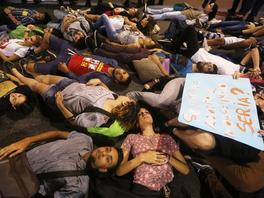 Pro-LGBT activists lie on the streets in Rio during