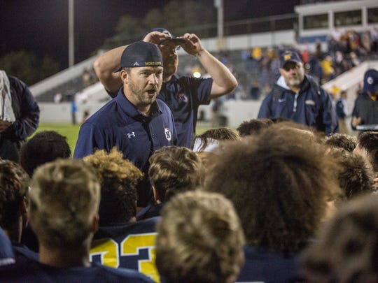 Port Huron Northern coach Larry Roelens talks with players after beating Marine City in a football game Thursday, September 1, 2016 at Memorial Stadium in Port Huron.during a football game Thursday, September 1, 2016 at Memorial Stadium in Port Huron.