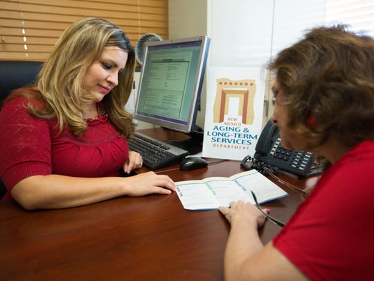 Southwest Regional Coordinator with the New Mexico Aging and Long-Term Services Department Stephanie Lazarin, left, shows colleague Lupe Blazon information available at the department's office in Las Cruces. Several free informational sessions will be offered throughout Las Cruces during October and November.