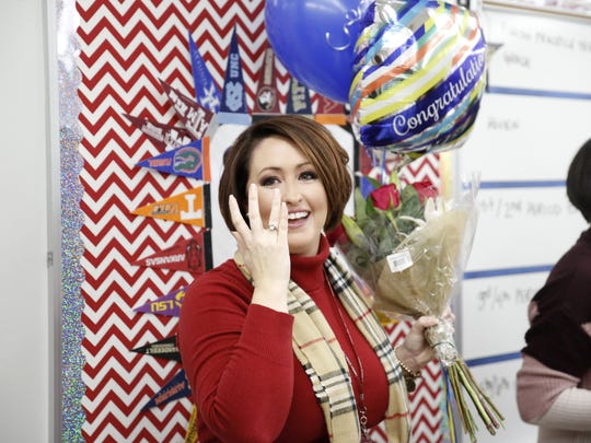 Jennifer Powell reacts after being surprised with the LCS Teacher of the Year award in her classroom at Chiles High School Wednesday.