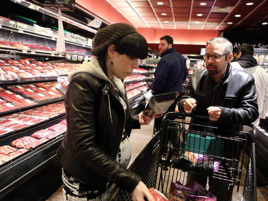 Elana and Giddy Straus choose a meat for their Shabbat