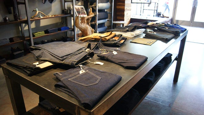 Jeans for sale at the Lawless Denim downtown Phoenix store on Wednesday, July 16, 2014.