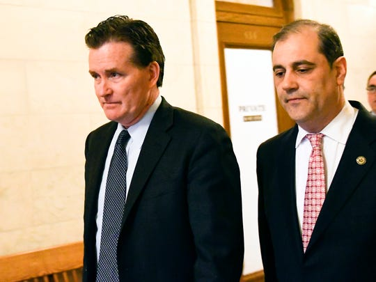 Senate Majority Leader John Flanagan, R-Smithtown, left, walks with Sen. Andrew Lanza, R-Staten Island to a meeting at the state Capitol Friday, March 30, 2018, in Albany, N.Y. (AP Photo/Hans Pennink)