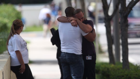 Angel Gardmac waits for information on several of his friends that were in the Pulse nightclub at the time of the shooting on Sunday, June 12, 2016.