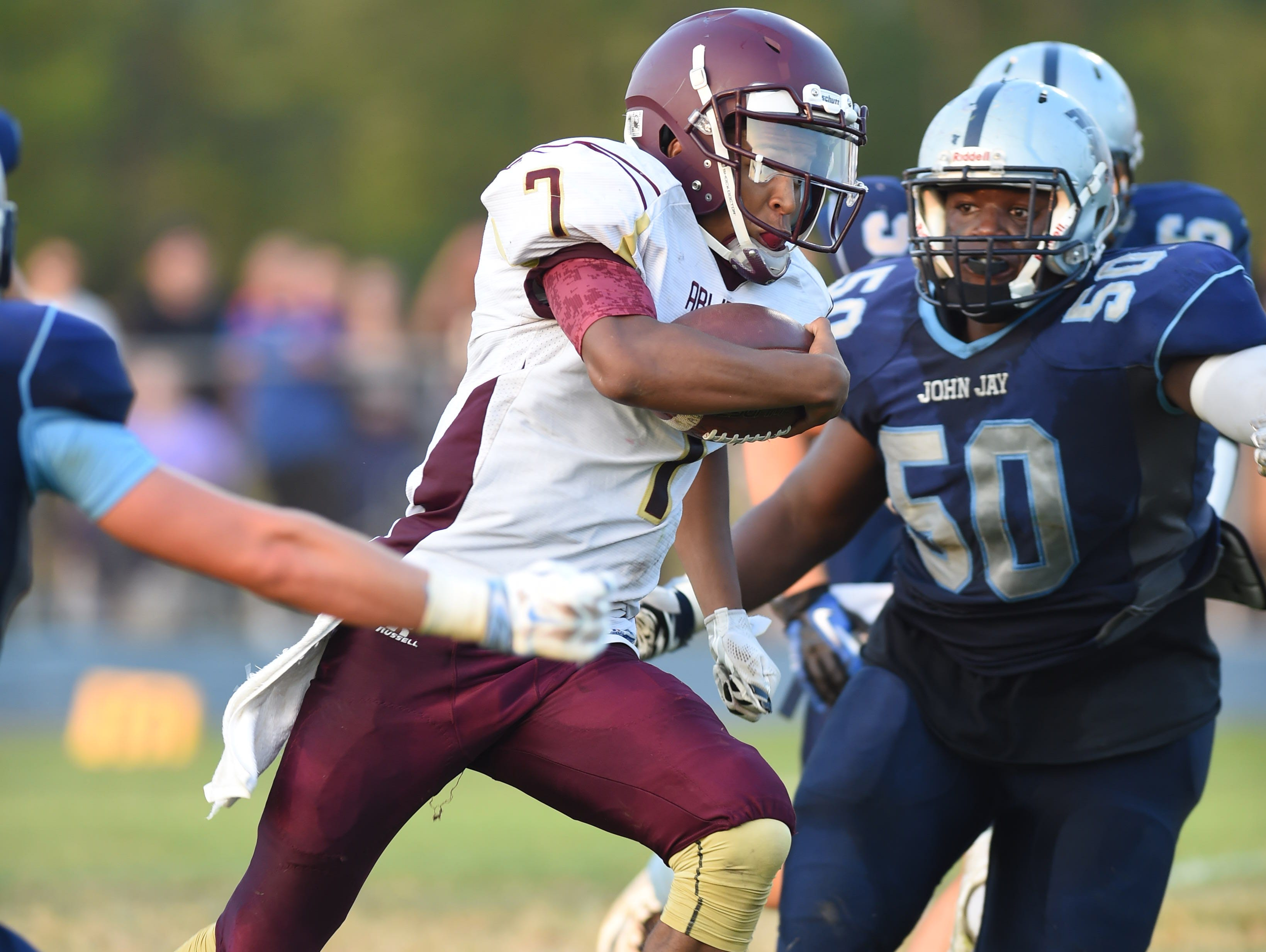 Arlington High School's Justin Leigh runs through John Jay defenders during their game in Wiccopee on Sept. 18.