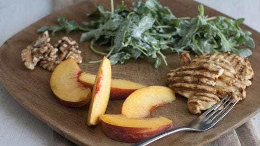 Grilled chicken paillards with peach and arugula salad.