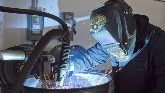 Mobsteel partner Steve Ryan welds a steel wheel in Detroit Steel Wheel, a spinoff of Mobsteel that makes customized steel wheels.