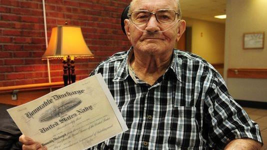 World War II Navy veteran Perry Seal, 88, shows his honorable discharge papers at the State Veterans Home in Collins. Seal joined the Navy after the bombing of Pearl Harbor, and served as a seaman in the Pacific throughout the war. Seal was honorably discharged April 1, 1946.