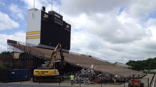 Workers began removing the south end zone bleachers inside Ross-Ade Stadium on June 11, 2014.