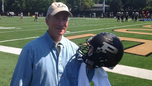 Purdue president Mitch Daniels at football practice.
