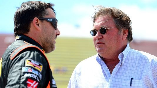 Tony Stewart talks with NASCAR vice president of competition Robin Pemberton, right.