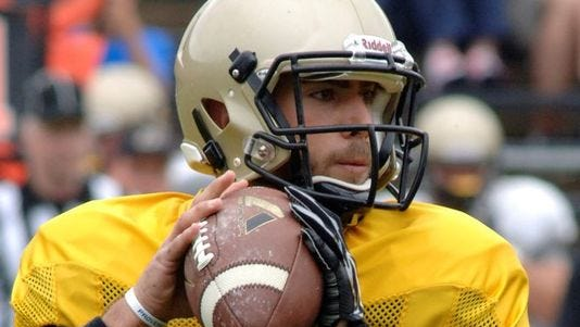 Austin Appleby looks for a receiver at Purdue's jersey scrimmage on Aug. 16, 2014 at Ross-Ade Stadium
