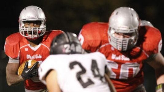 West Lafayette lineman Peyton Truitt (right) opens a hole.