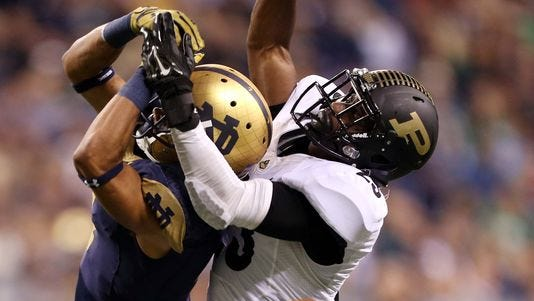 Purdue cornerback Antoine Lewis (right) breaks up a pass intended for Notre Dame wide receiver Will Fuller.