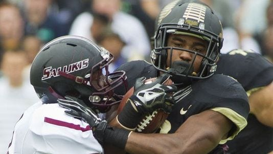 Purdue's Raheem Mostert tries to get around Southern Illinois' Lamonte Edwards.