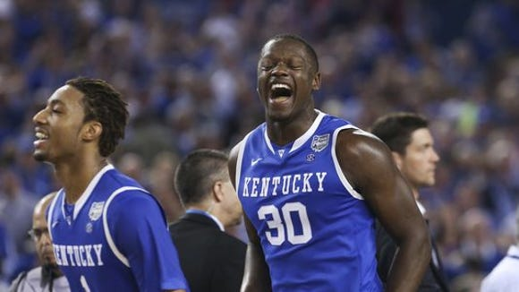 UK's Julius Randle, #30, right, and James Young, #1, celebrated after Aaron Harrison, #2, hit the game winning shot against Wisconsin during their Final Four game at the AT&T Stadium in Arlington, TX. Apr. 5, 2014