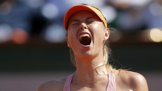 Maria Sharapova celebrates after beating Simona Halep in the women's French Open final on Saturday in Paris.