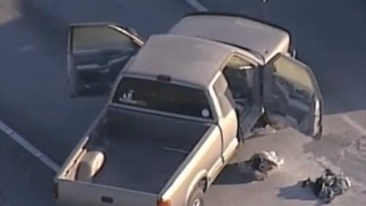 A photo taken from video shows a truck that police say was driven by a man who was shot.