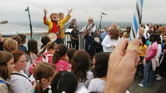 Local folk legend, the late Pete Seeger, performs with Beacon and Poughkeepsie students during the opening of the Walkway Over the Hudson on Oct. 3, 2009.
