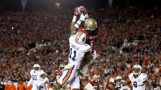 FSU receiver Kelvin Benjamin comes down with the game-winning touchdown catch against Auburn in the BCS title game last January at the Rose Bowl.