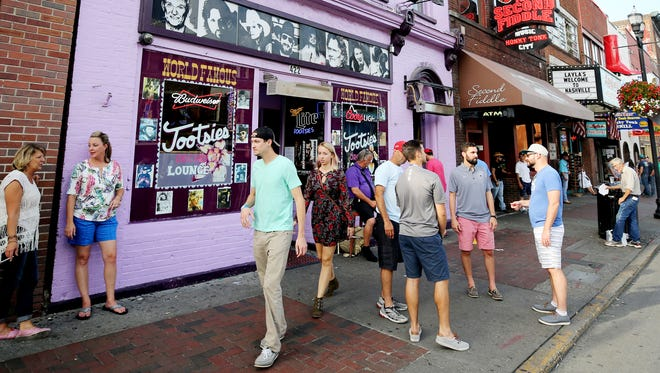 Visitors to Lower Broadway make their way past Tootsie's on Aug. 27, 2017.