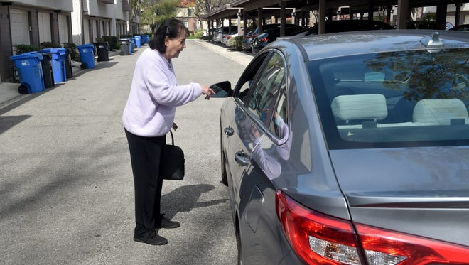JoAnn Wacht, of Westlake Village, meets with a driver named Aaron Hodnett, who responded to her GoGoGrandparent ride service call on Monday. GoGoGrandparent helps older adults use ride services if they don't have a smart phone.