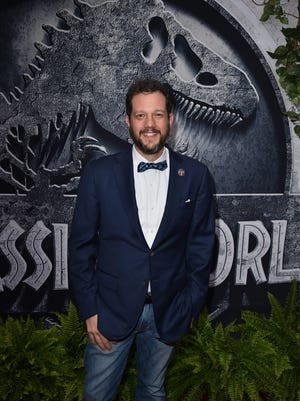 Composer Michael Giacchino attends is all smiles at the 'Jurassic World' premiere at the Dolby Theatre.