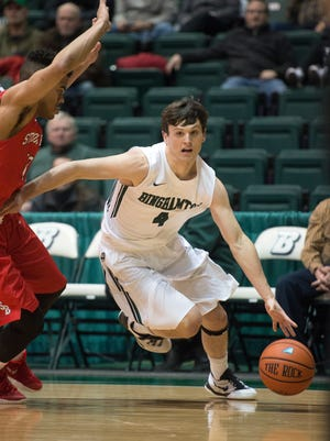 Binghamton University guard Timmy Rose drives to the basket during the Bearcat's 62-52 loss to Stony Brook at home on Wednesday, Jan. 6, 2016.