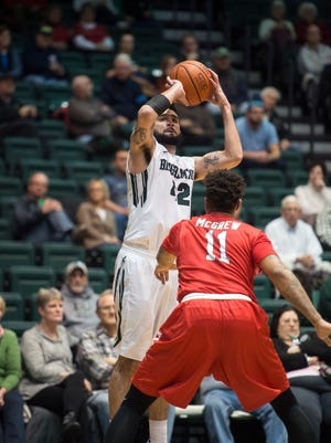 Binghamton University forward Willie Rodriguez puts up a shot during the Bearcat's 62-52 loss to Stony Brook at home on Wednesday, Jan. 6, 2016.