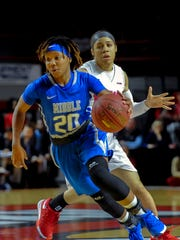 Middle Tennessee's guard Ty Petty (20) dribbles Thursday, February 25, 2016, past Western Kentucky's Taylor Brown (2) during a game at E.A. Diddle Arena.