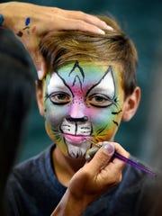Hugh Patrick Hazelwood gets his face painted at Saturday's