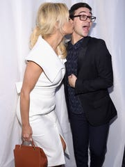 Pamela Anderson and designer Christian Siriano  attend