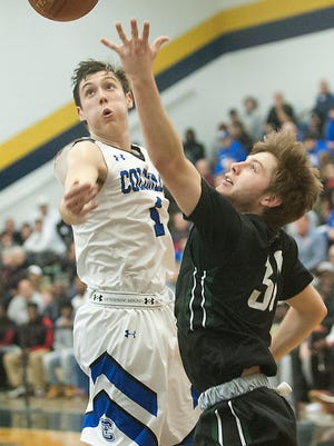 Covington Catholic forward C.J. Fredrick watches the flight of the ball put up by Trinity guard Brendan King. 
