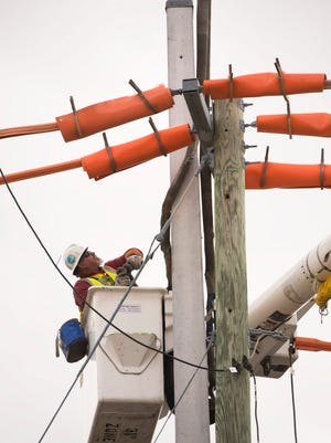 Florida Power & Light Co. line specialist Steve Bruno takes off the sling that secured the recently installed concrete utility pole to the crane as he and the FPL field crew install new utility poles designed to withstand winds of up to 145 mph, at 700 Flamingo Ave. on Thursday, March 30, 2017 in Stuart. To see more photos, go to TCPalm.com.