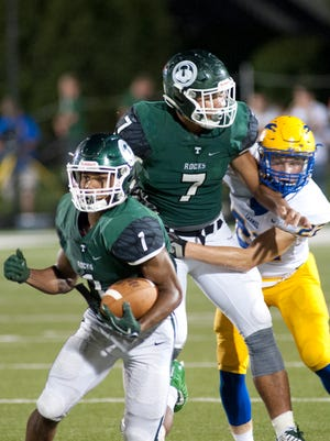 Trinity's Stephen Herron gets between Trinity wide receiver Rondale Moore and Carmel (In.) safety Nate Frey, right, as Moore looks to break free of the defense.18 August 2017