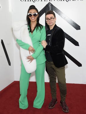 Cardi B poses with designer Christian Siriano at the