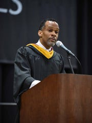 Farmington Board of Education trustee David Turner, here speaking at a graduation ceremony, was one of two finalists being considered as a replacement for former President Jim Stark, who resigned last month.