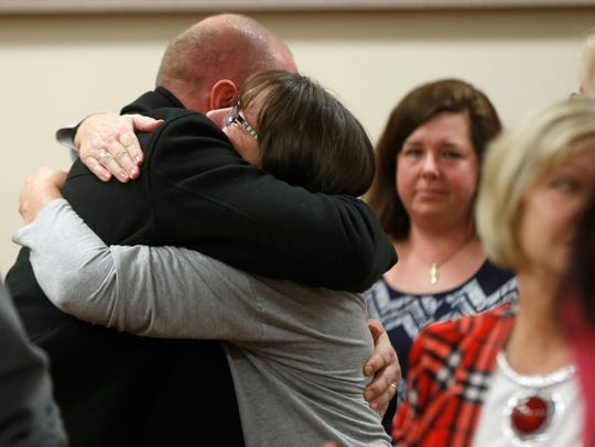 Friends and family hug following the guilty verdict