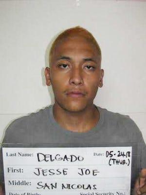 Jesse Joe San Nicolas Delgado is shown in a May 24, 2018 booking mugshot.