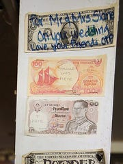 Signed currency adorns one of the walls in the Old Town Pub in Silverdale.